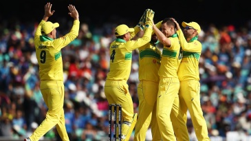 Australia's players get together to celebrate a wicket