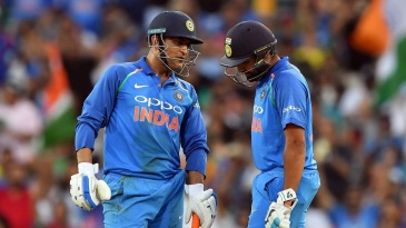 MS Dhoni and Rohit Sharma chat during their partnership