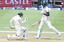 Quinton de Kock and Kagiso Rabada pump their fists after de Kock gets his hundred, South Africa v Pakistan, 3rd Test, Johannesburg, 3rd day, January 13, 2019