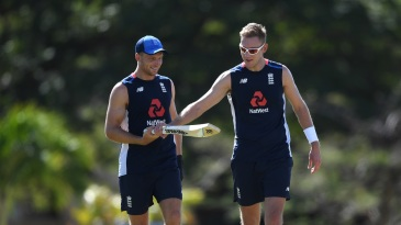 Stuart Broad has a look at Jos Buttler's bat at training