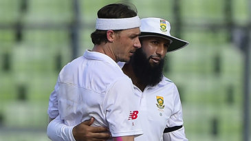 Dale Steyn and Hashim Amla celebrate a dismissal