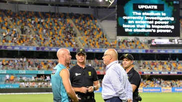 Chris Lynn and match officials have a chat after a power blackout forced the BBL game to be abandoned