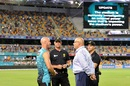 Chris Lynn and match officials have a chat after a power blackout forced the BBL game to be abandoned, Brisbane Heat v Sydney Thunder, BBL 2018-19, Brisbane