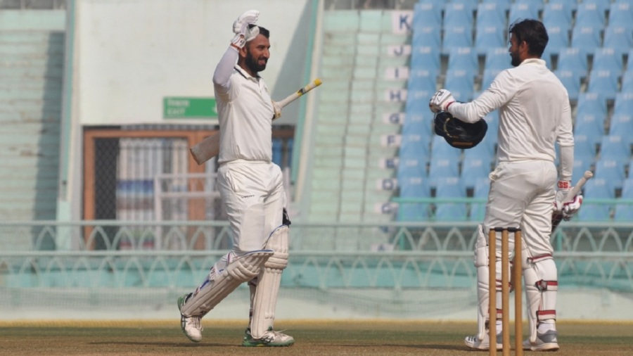 Cheteshwar Pujara and Sheldon Jackson celebrate