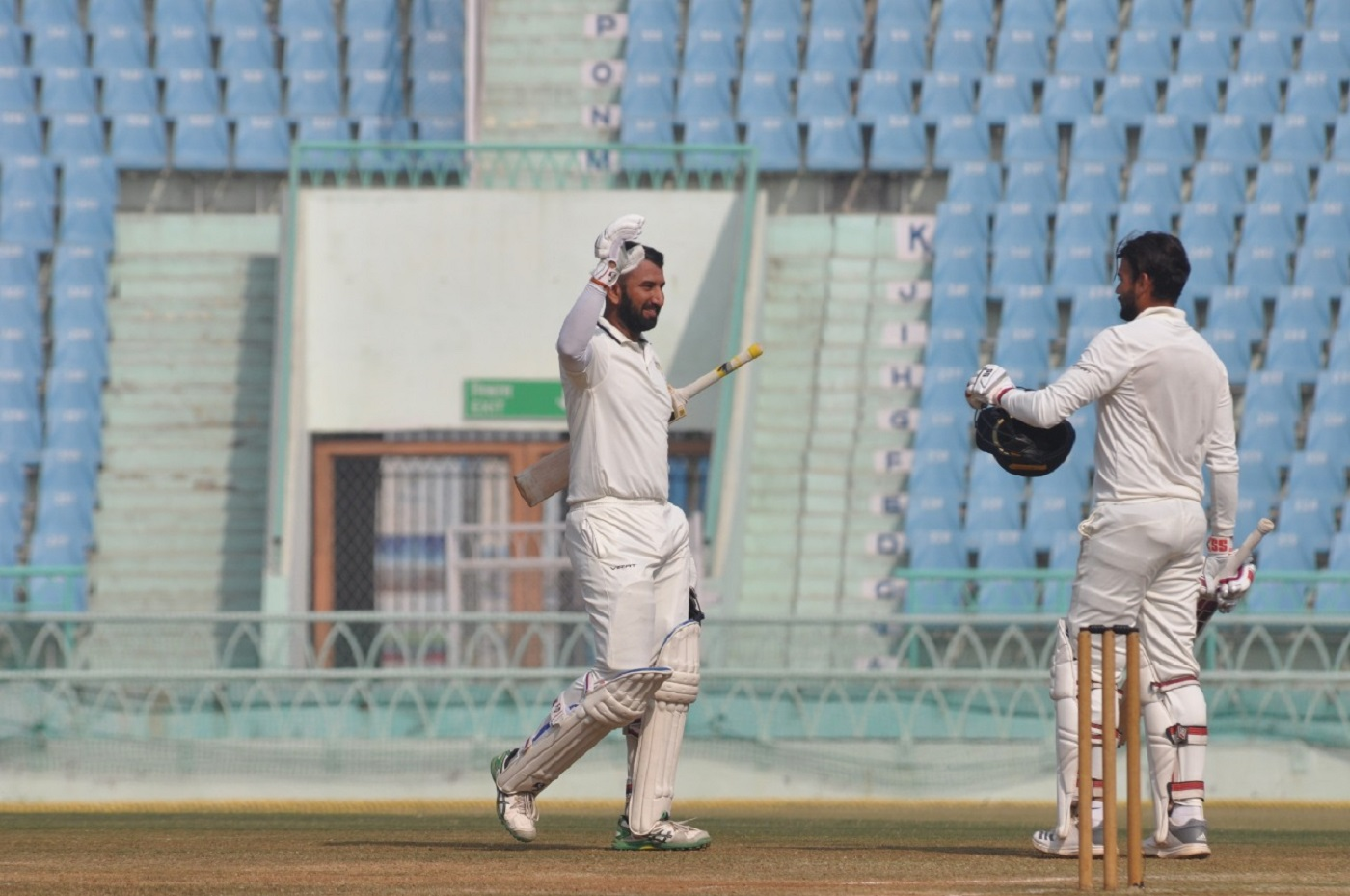 Pujara celebrates with Saurashtra team-mate Sheldon Jackson after taking the side into the 2019 Ranji Trophy final: