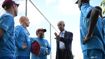 Sir Garfield Sobers demonstrates his wrist position to West Indies' coaching staff