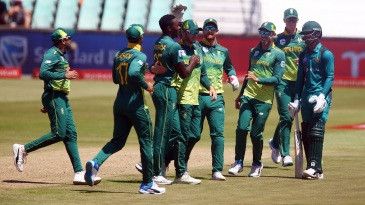 Kagiso Rabada is mobbed by his team-mates