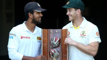 Dinesh Chandimal and Tim Paine pose with the Warne-Muralitharan Trophy