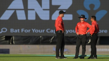 Match officials wait for the sun to move in Napier