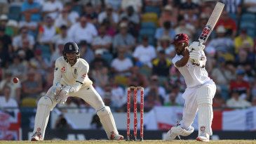 Roston Chase drives through the covers