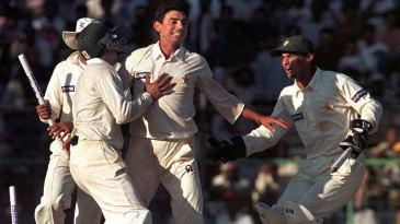 Saqlain Mushtaq celebrates the dismissal of the final Indian batsman - Javagal Srinath