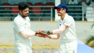 Umesh Yadav is congratulated after one of his wickets
