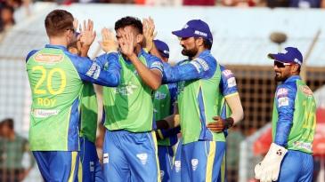 The Sylhet Sixers fielders celebrate a wicket
