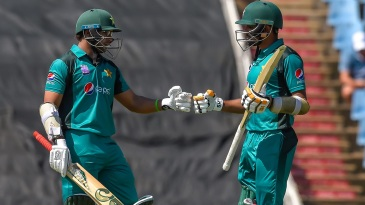 Imam-ul-Haq and Babar Azam fist-bump each other