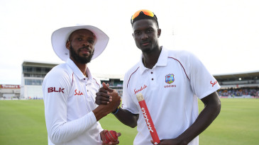 Roston Chase and Jason Holder celebrate West Indies' victory
