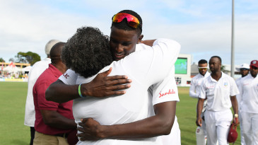 West Indies captain Jason Holder is congratulated by Barbados Prime Minister Mia Mottley