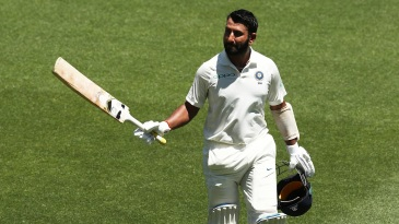 Pujara walks off to applause