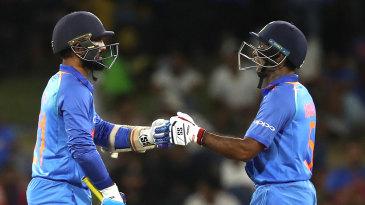 Dinesh Karthik (left) and Ambati Rayudu bump fists during their partnership
