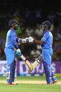 Dinesh Karthik (left) and Ambati Rayudu bump fists during their partnership, New Zealand v India, 2nd ODI, Mount Maunganui, January 28, 2019