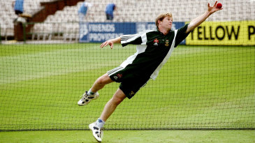 Jonty Rhodes stretches to take a catch during training
