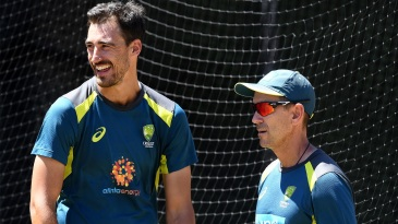 Mitchell Starc and Justin Langer at a training session
