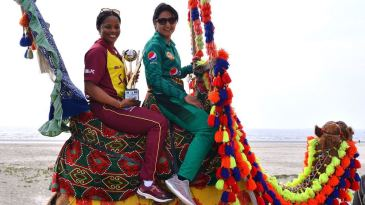 Merissa Aguilleira and Bismah Maroof pose with the T20I trophy