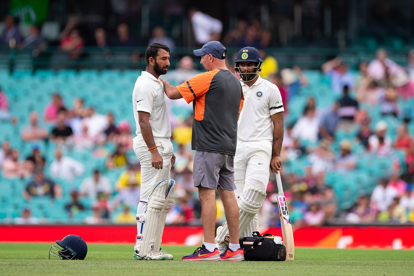 Dr Fix-it: physio Patrick Farhart was ever ready with some TLC for Pujara through the series
