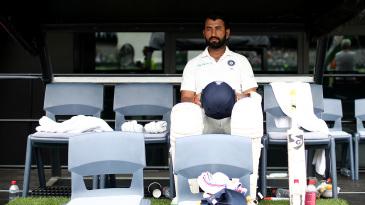 Cheteshwar Pujara waits for his turn to bat