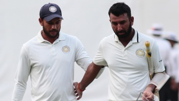 Sheldon Jackson and Cheteshwar Pujara walk off after another good day's work