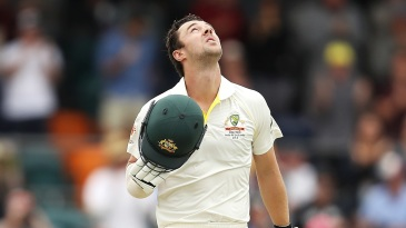Travis Head looks at the heavens after reaching his first Test century
