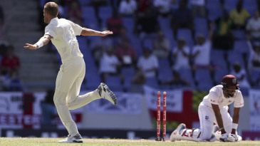 Stuart Broad removed Roston Chase's off stump (and left him on his knees)