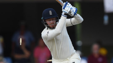 Jonny Bairstow winces after being bowled by Jason Holder