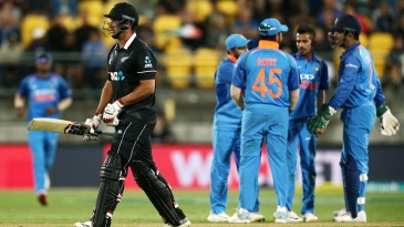 Colin de Grandhomme walks back after being trapped in front