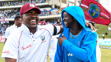 Darren Bravo and Kemar Roach celebrate West Indies' series win