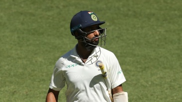 Cheteshwar Pujara walks back