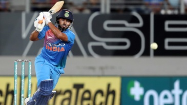 Rishabh Pant plays the ball down the ground