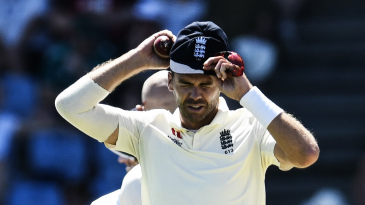James Anderson of England puts on his cap