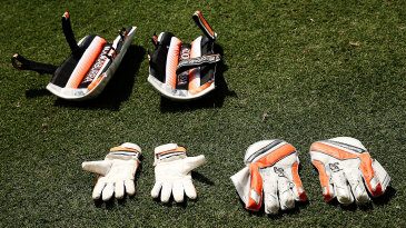 Chris Hartley's wicketkeeping gloves and pads get an airing