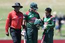 Mushfiqur Rahim inspects his helmet after being hit by a bouncer, New Zealand v Bangladesh, 1st ODI, Napier