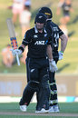 Henry Nicholls raises his bat after getting to fifty, New Zealand v Bangladesh, 1st ODI, Napier