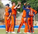 Fred Klaassen gets a round of high fives after his first wicket of the day, Netherlands v Scotland, Oman Quadrangular T20I Series, Al Amerat, February 13, 2019