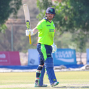 Paul Stirling raises his bat to the Ireland dressing room after completing a half-century, Oman v Ireland, Oman Quadrangular T20I Series, Al Amerat, February 13, 2019