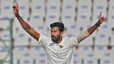 Sandeep Warrier celebrates after taking a wicket