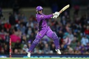 George Bailey is airborne as he steers the ball on to the off side, Hobart Hurricanes v Melbourne Stars, Big Bash League 2018-19, semi-final, Hobart, February 14, 2019