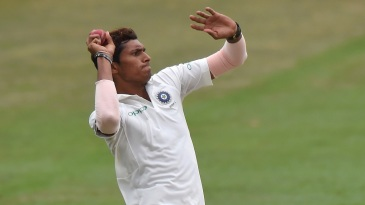 Navdeep Saini runs in to bowl