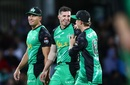 Daniel Worrall celebrates with his team-mates after his fourth wicket of the match, Hobart Hurricanes v Melbourne Stars, BBL 2018-19, Hobart, February 14, 2019