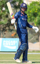 Calum MacLeod raises his bat toward the Scotland dressing room after reaching his fifty, Netherlands v Scotland, Oman Quadrangular T20I Series, Al Amerat, February 13, 2019