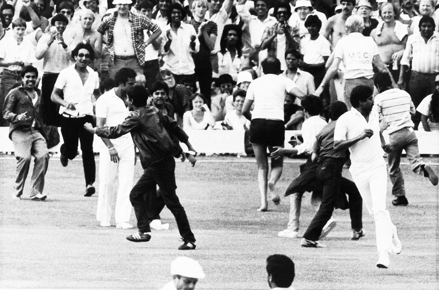 Fans run on to the field to celebrate Kapil Dev's catch to dismiss Viv Richards