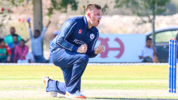 Mark Watt roars after taking his third wicket in a game-changing spell