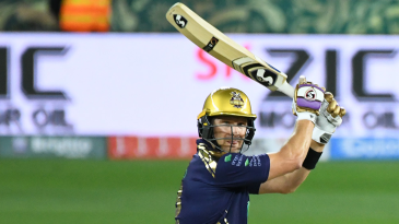 Shane Watson holds his shape after punching the ball